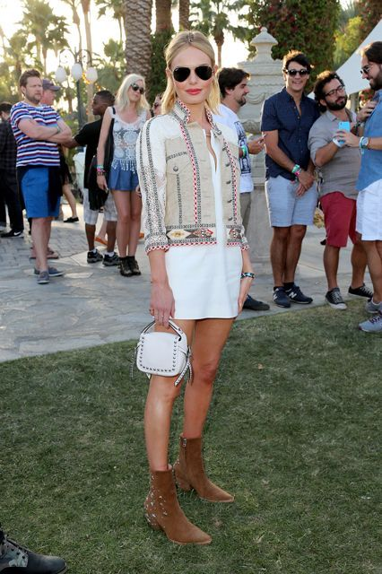 Coachella has become just as much about the fashion as it about is the music, if not more so. This is a place to be seen in your finest and flyest boho-inspired threads, and no one has that down to an art better than Kate Bosworth. The actress and style icon was effortlessly cool — and Coachella-appropriate — in an LWD paired with an awesome lightweight jacket, eternally cool aviator sunglasses, and sexy, calf-high boots