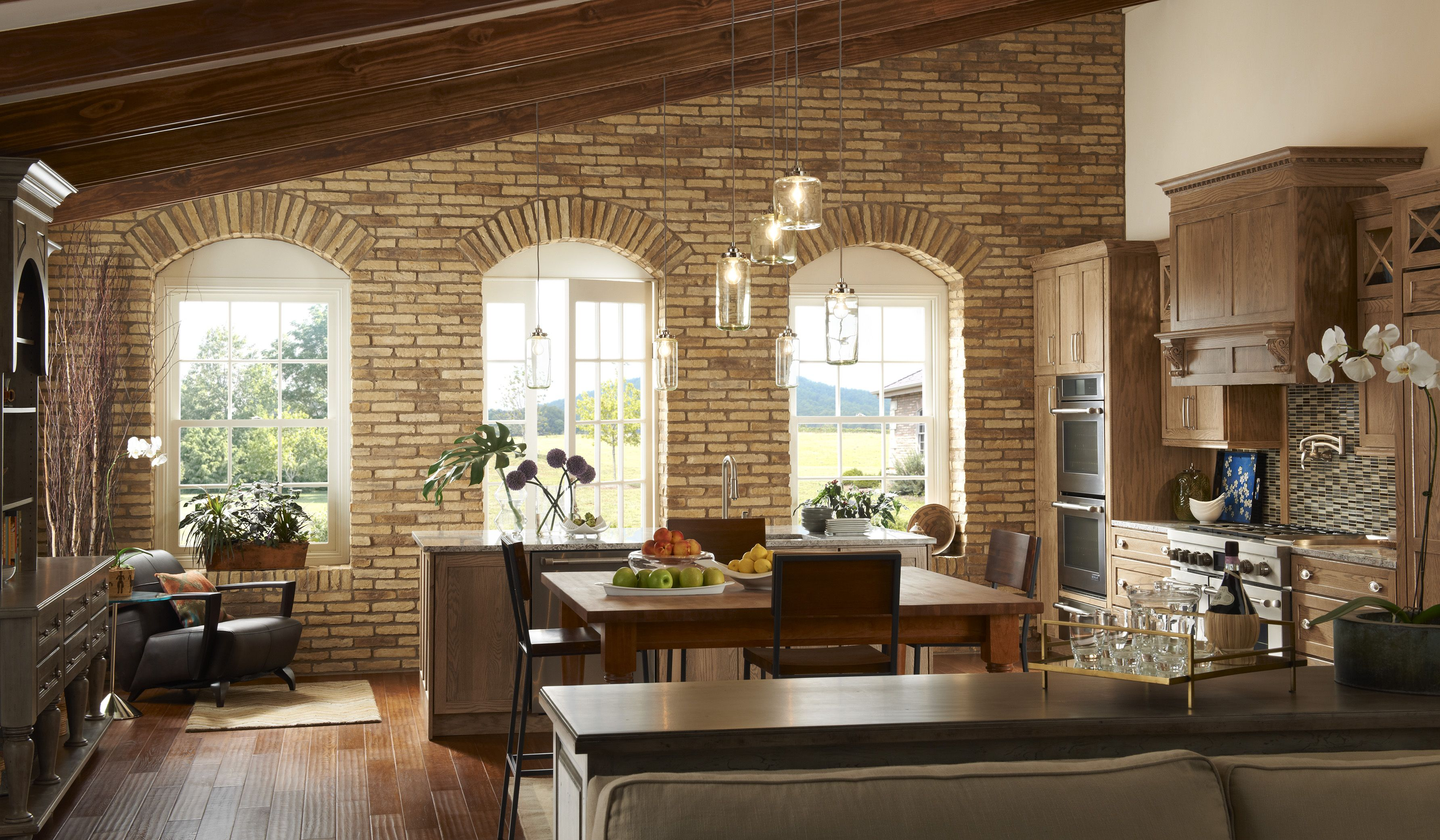 Brick Accent Wall In Kitchen And Arched Windows Stone