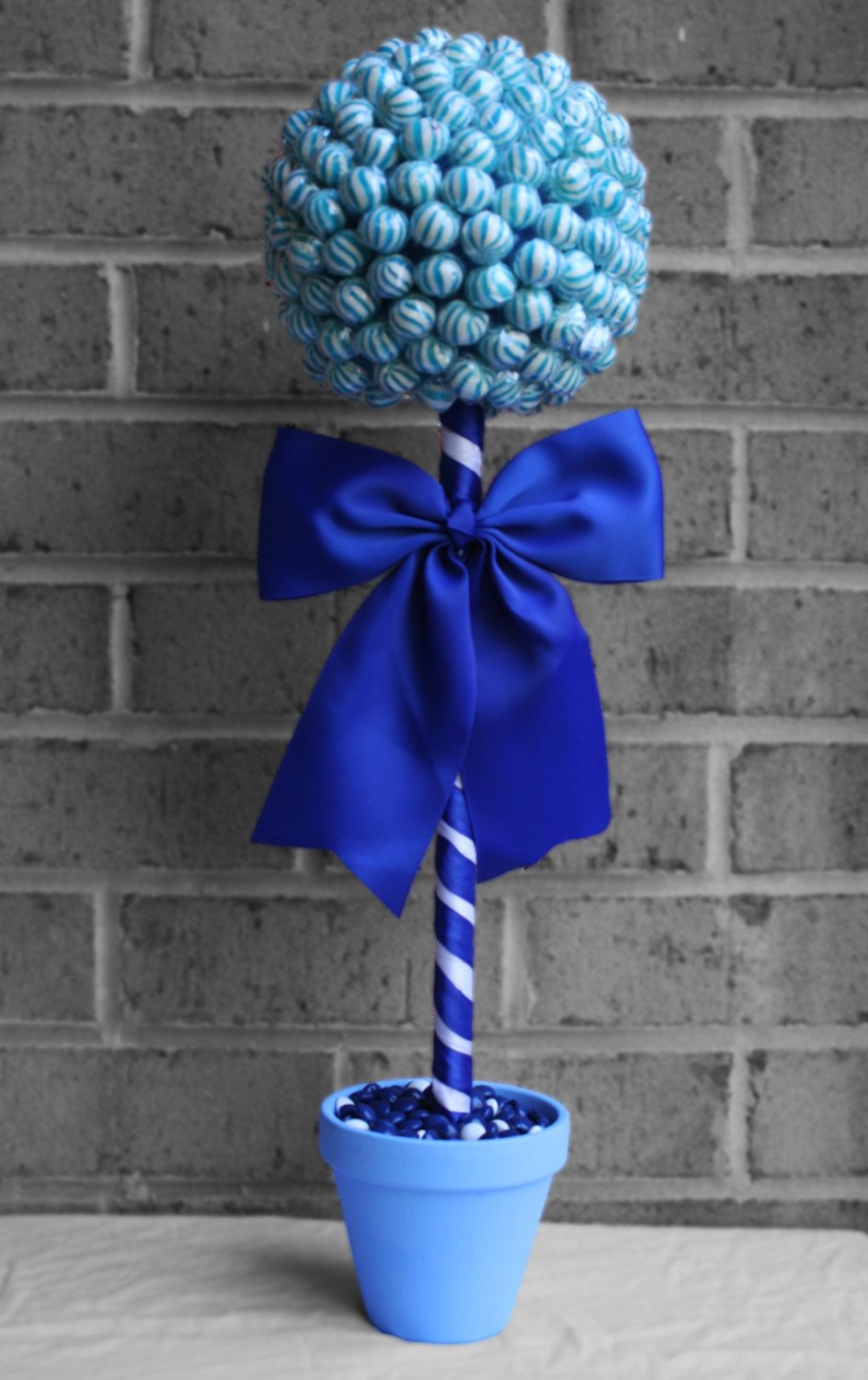 Large blue lollipop topiary candy