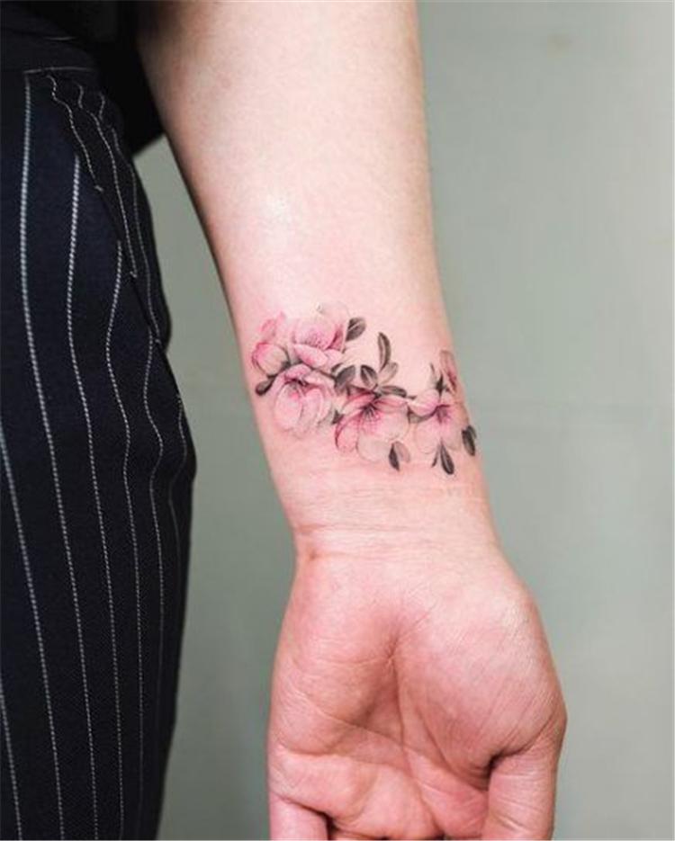Meaningful Wrist Bracelet Floral Tattoo Designs You Would Love To Have Floral Tattoo Bracelet Flo Wrist Tattoos For Women Blossom Tattoo Flower Wrist Tattoos