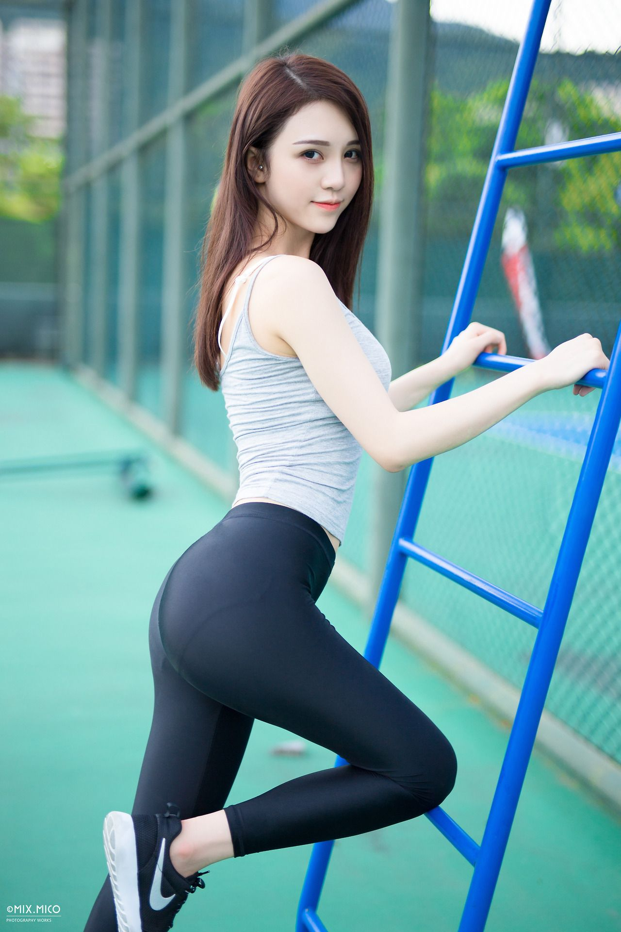 Cute asian girl with tight jeans