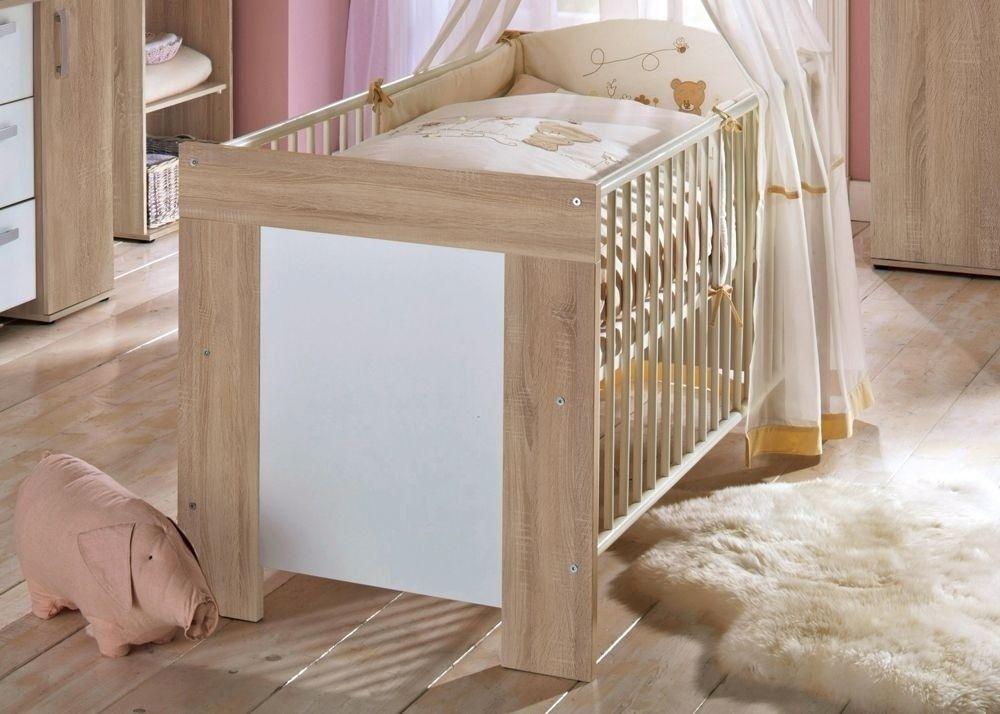 Babybett Michi sägerau 6150. Buy now at https://www.moebel-wohnbar.de/babybett-michi-kinderbett-gitterbett-weiss-mit-eiche-saegerau-6150.html