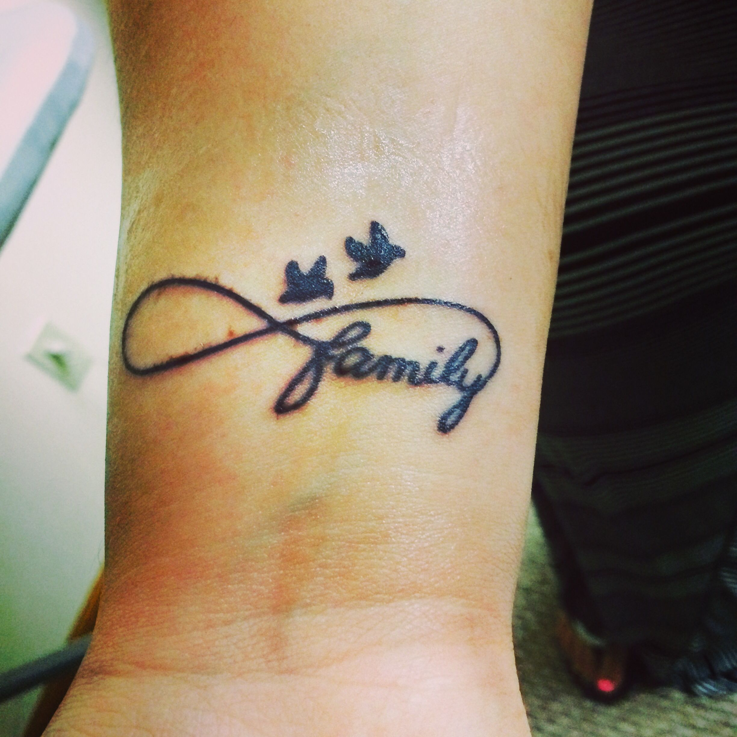 This Is My Lovely Family Tattoo The Word Family Is In A Infinity Sign Because Family Is Infinite And The Birds Represent My Family Tattoos New Tattoos Tattoos
