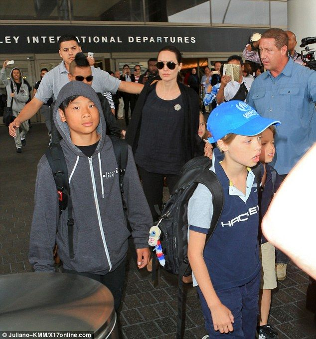 Angelina Jolie and Brad Pitt arrive at LAX with their six children
