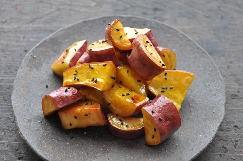 Daigakuimo  300g sweet popatos  ( 5mm-1cm) sliced    4T grapeseed oil    4T sugar    1/2t soy sauce   1/2t vinegar    1T water     1) Put oil, sugar, soy sauce, vinegar and water into a pan and stir quietly till sugar melt.    2) Add sliced sweet potato into the pan and simmer until the slices are tender (about 15-20min), turning occasionally.