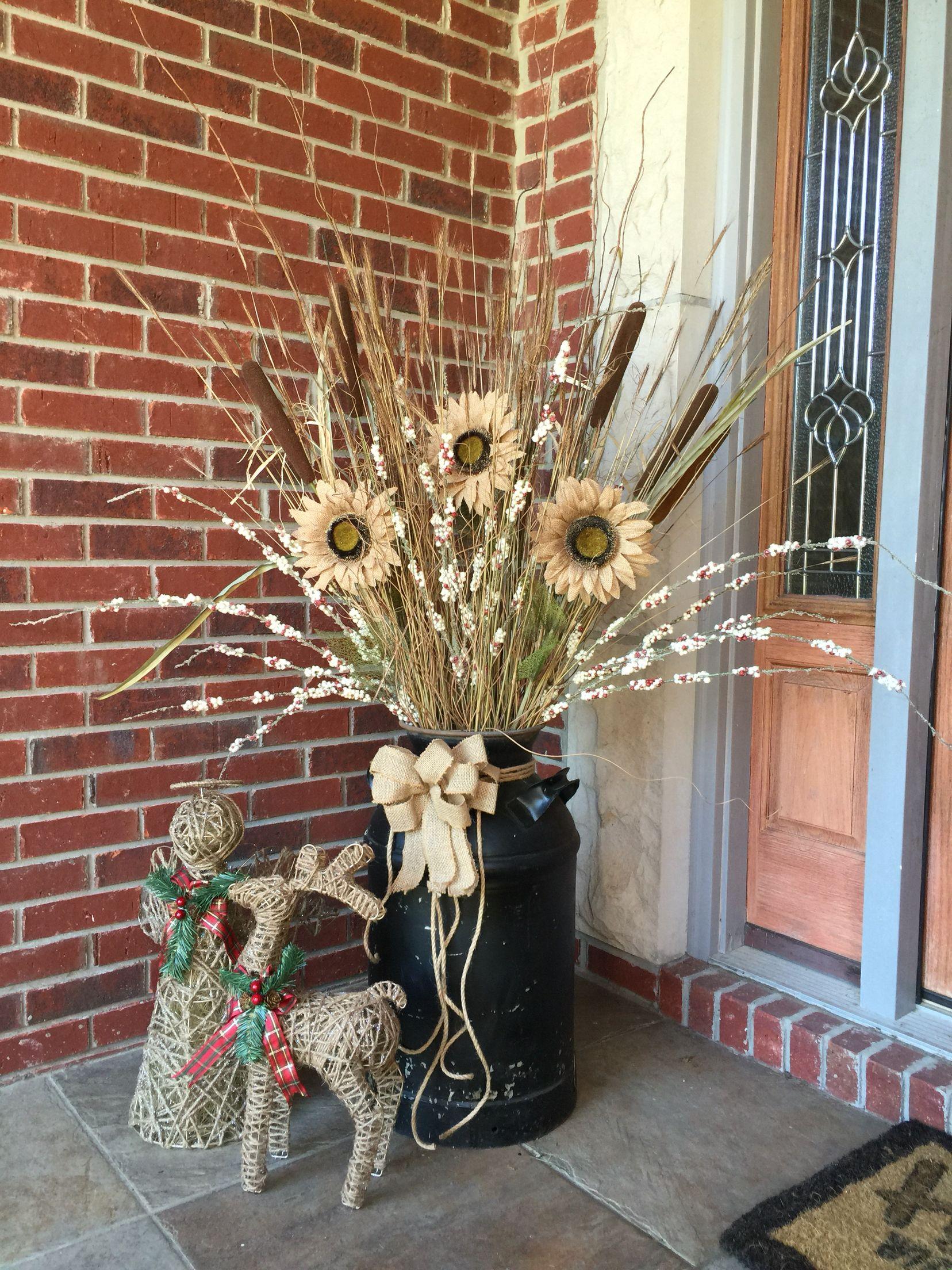 Old milk can, front porch decor, sunflowers Front porch