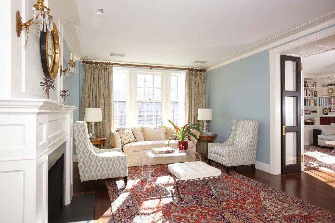 Great transitional living room- pale green curtains, blue walls ...