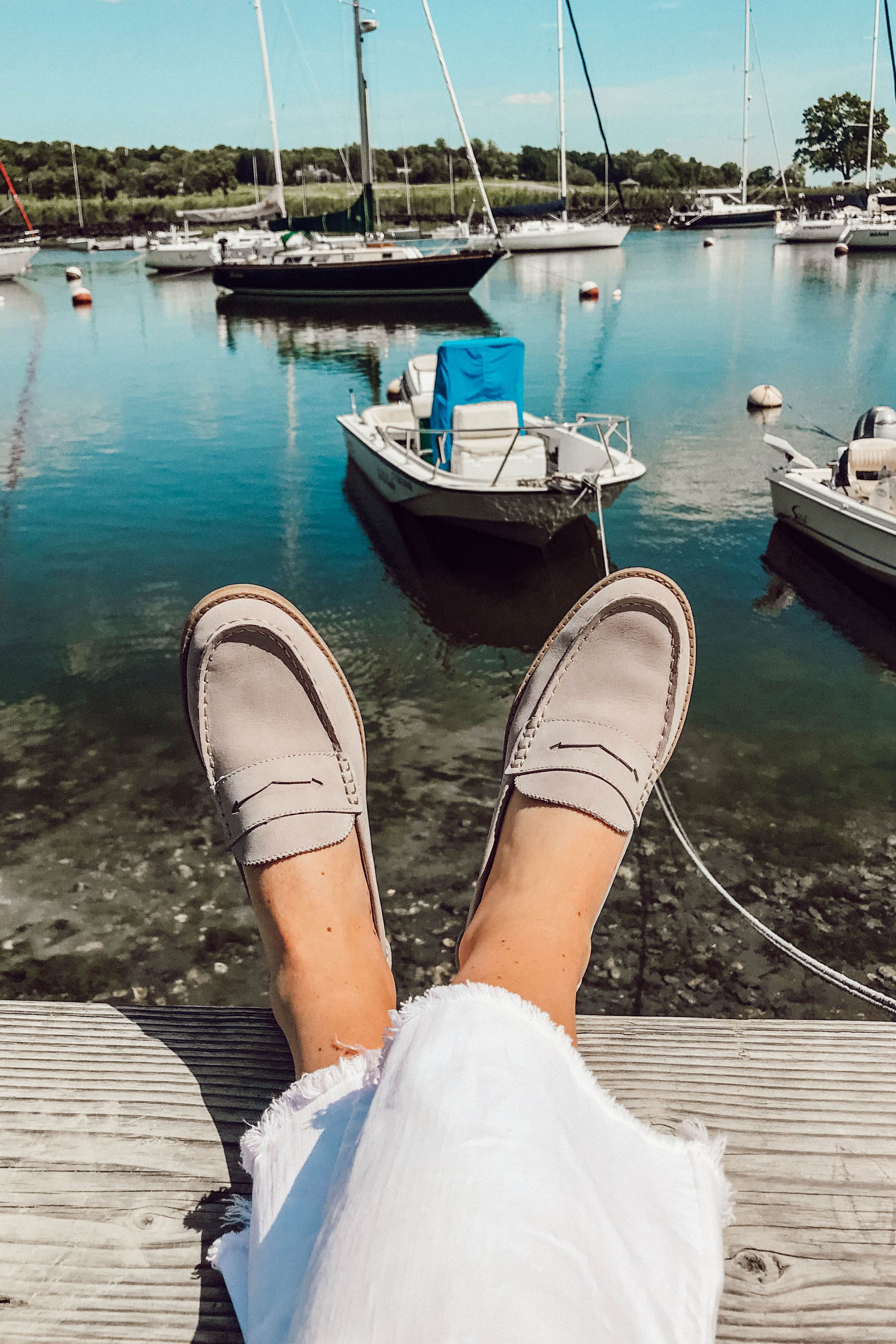4574d765a64  elizahiggins  SperryMyWay Style blogger Eliza Higgins wears the Seaport  Penny Loafer in grey with a pair of white cut-off jeans.