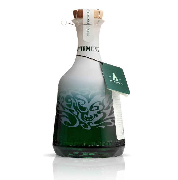 """""""Our design was inspired by the swirling, cloudy patterns that form when the absinthe is mixed with water. The bottle shape was inspired by the water carafes found in cafe's throughout France."""" - Le Tourment Vert, Pearlfisher"""