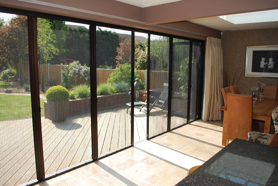 large patio door with fly screens letting fresh air in and