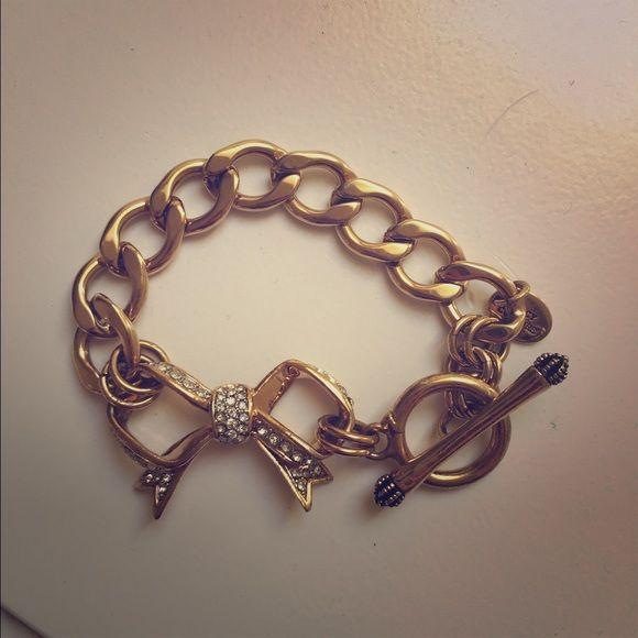 Juicy Couture Bow Charm Bracelet Gold Charm Bracelet. No charms included. No broken pieces/damage. Super cute! Juicy Couture Jewelry Bracelets