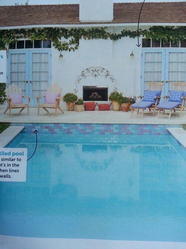 Violet and aqua tiles along this pool