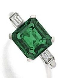 EMERALD AND DIAMOND RING, CIRCA 1930. The emerald-cut emerald weighing 3.63 carats, flanked by 2 baguette diamonds, mounted in platinum