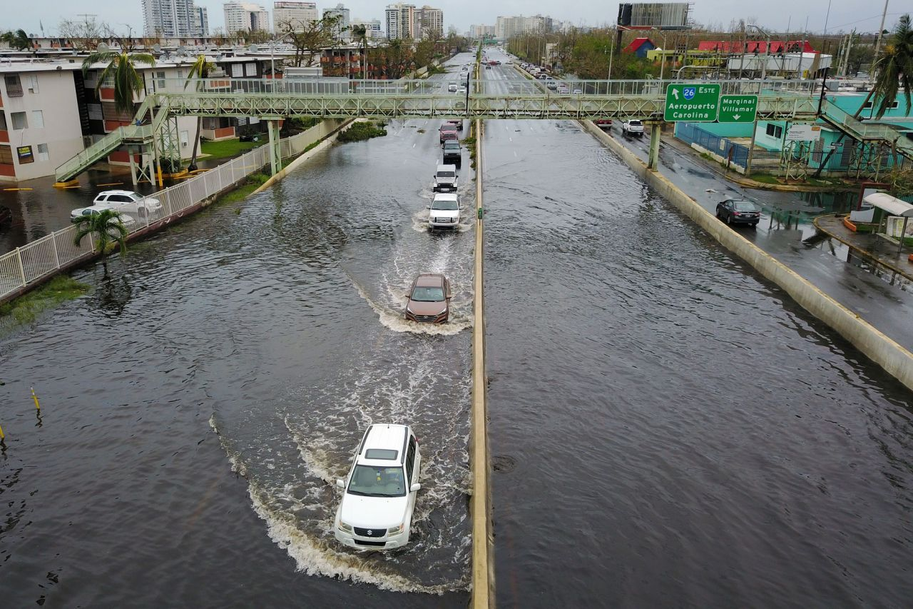 P Cars Drive Through A Flooded Road In The Aftermath Of Hurricane Maria In San Juan Puerto Rico On Sept 21 2017 Puerto Rico History Puerto Rico Hurricane