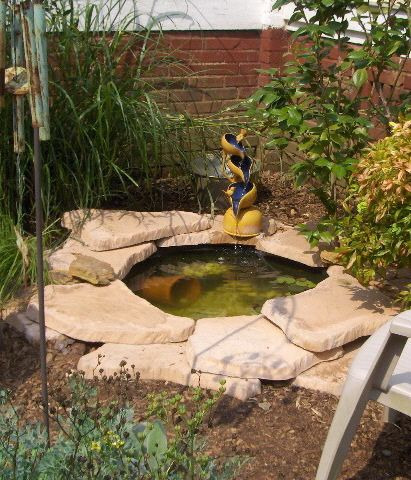 Garden small and beautiful fishpond in the backyard for Fish ponds for small gardens