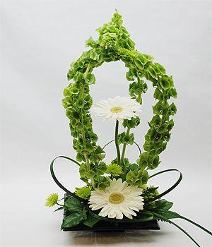 A St Patrick S Day Favorite Bells Of Ireland White Gerberas Green Kermits And Lily Grass Al Valentines Flowers Flower Decorations Ikebana Arrangements