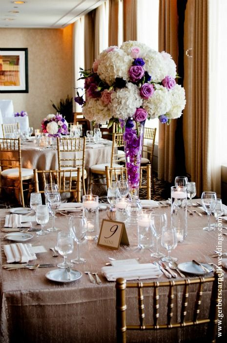 Elevated Centerpieces Atop Glass Trumpet Vases Wedding