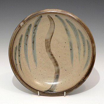 Stoneware plate with willow tree decoration. Leach Pottery