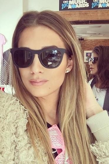 0a37608610e31 Jessie James Decker wearing Cupcakes and Cashmere Jessica Faux Fur Jacket  and Rixx Eyewear Delano Sunglasses