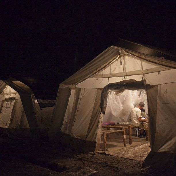 #Photostory 5/7: The tents of the in-patient department in #Batil hospital. #Dr Roberto Scaini attends to a #patient. #SouthSudan, 2012 Olga Overbeek/#MSF
