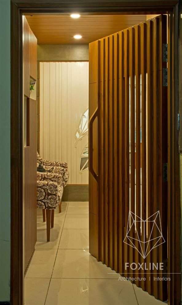 A Wooden Door With With Safety Shutter Bars Archstudio