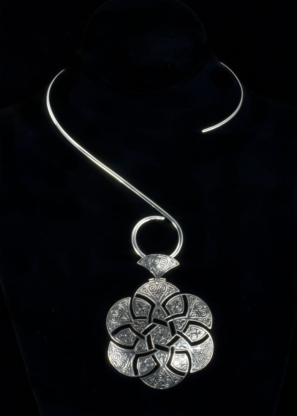 "Sterling Silver Ornate Necklace  This a beautiful piece of jewelry. Large ornate sterling silver pendant, 3-1/2"""" x 2-1/2""""W including bail. Pendant hangs on a sterling silver """"S"""" neck collar.   http://www.sterlingjewelrystores.com/product572.html"