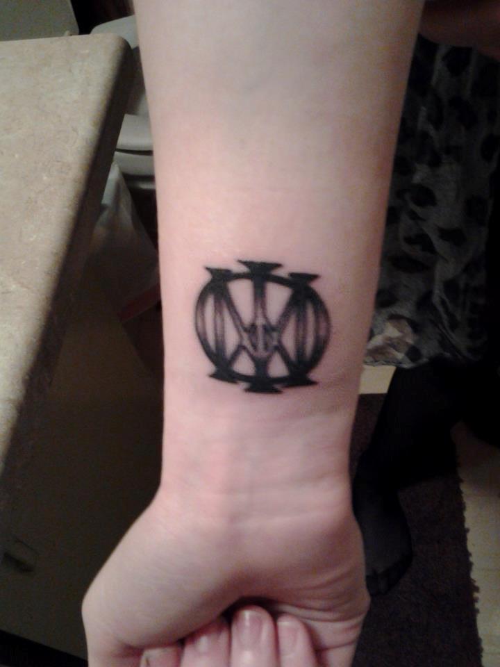 Majesty Symbol on wrist.