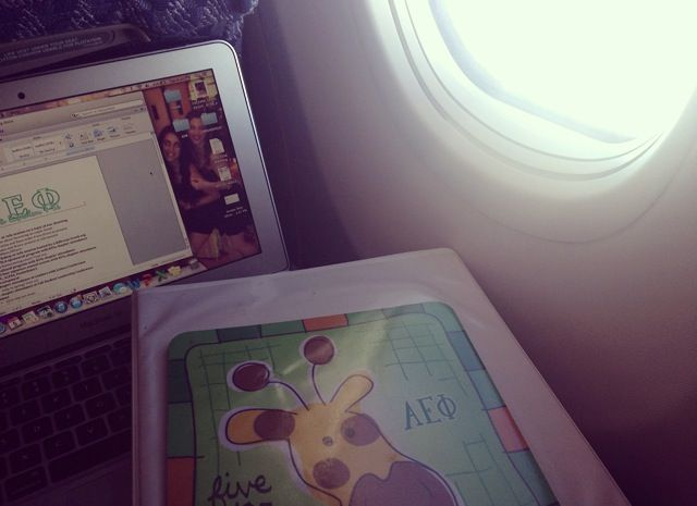 Never stopping sorority work, even in flight. TSM.