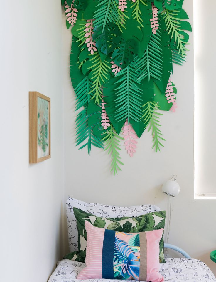 a neutral guest bedroom is transformed into tropical kids room decorating with plants in - Tropical Bedroom Decoration