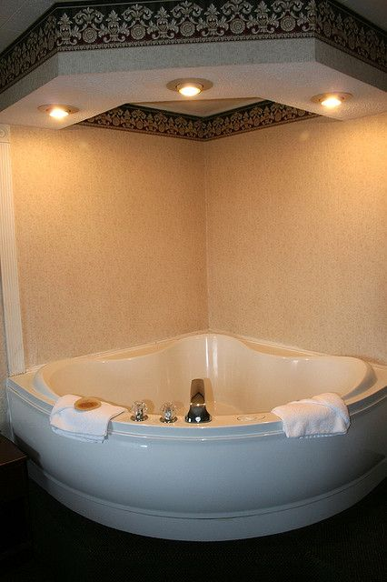 Bathroom Lights Keep Dimming gorgeous corner jacuzzi with bowl shaped bottom and drop down