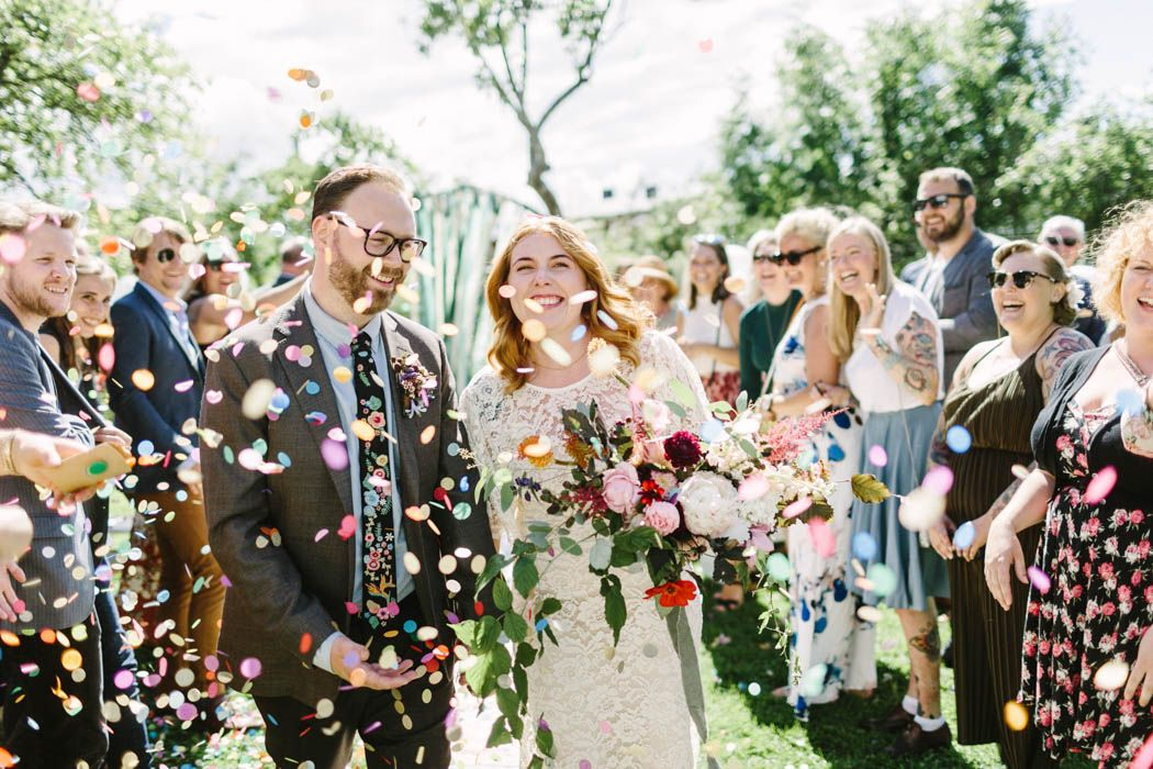 This magical Oslo wedding is bursting with color, energy, and impeccably designed details created by the wedding planner bride and graphic designer groom.