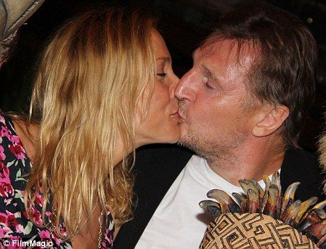 Happy families: Liam Neeson joins his girlfriend and her