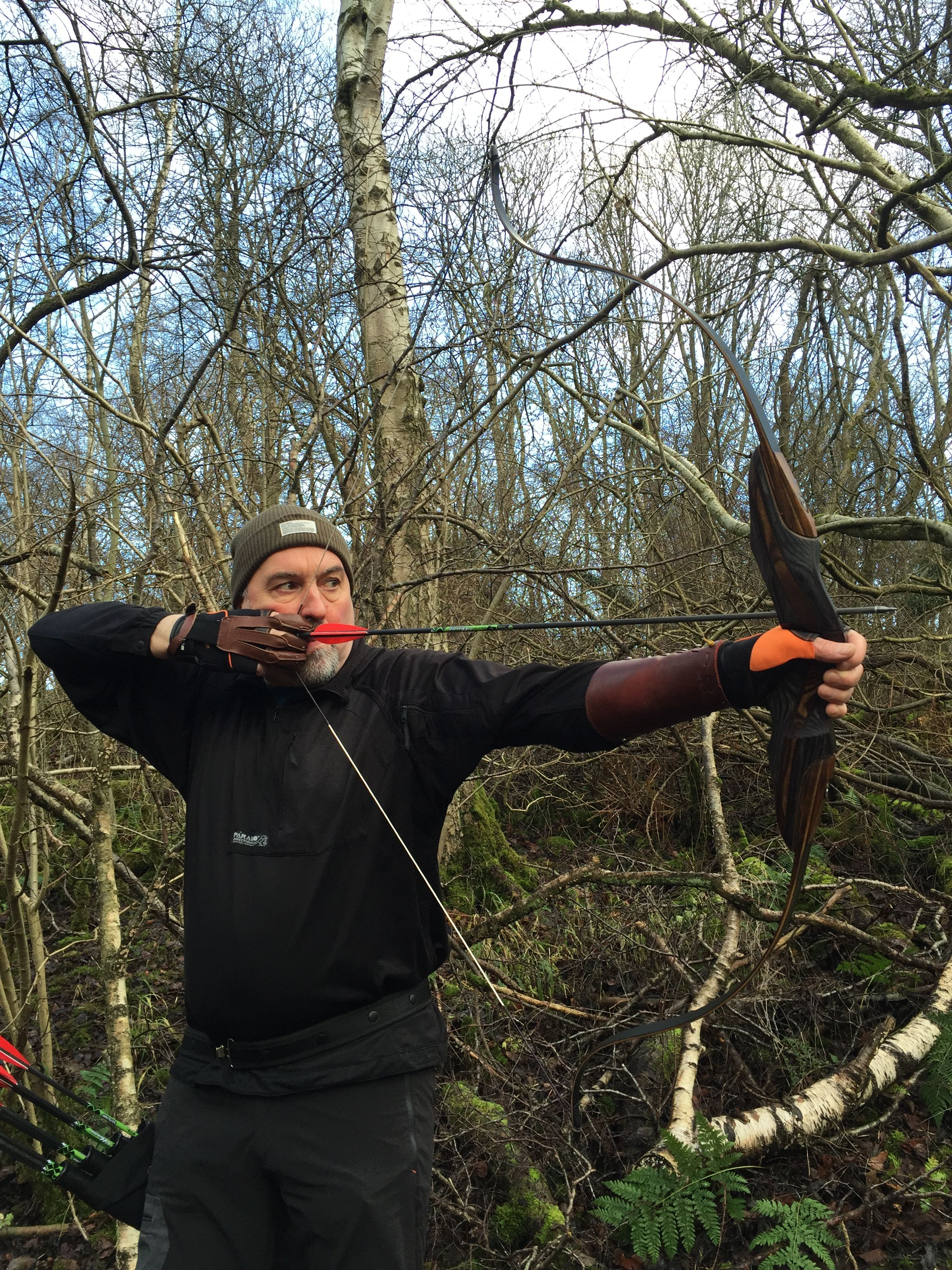 Full draw, second finger anchored in corner of mouth - bow canted