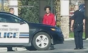 This photo of Darrien Hunt taken just moments before he was shot and killed by police was taken by a woman standing across the street pumping gas who only took the photo because his tall afro was a bit of an anomaly in those parts. She maintains that she looked away after taking the photo and didn't think much of the stop, which seemed peaceful, until shots rang out moments later and Darrien was dead.