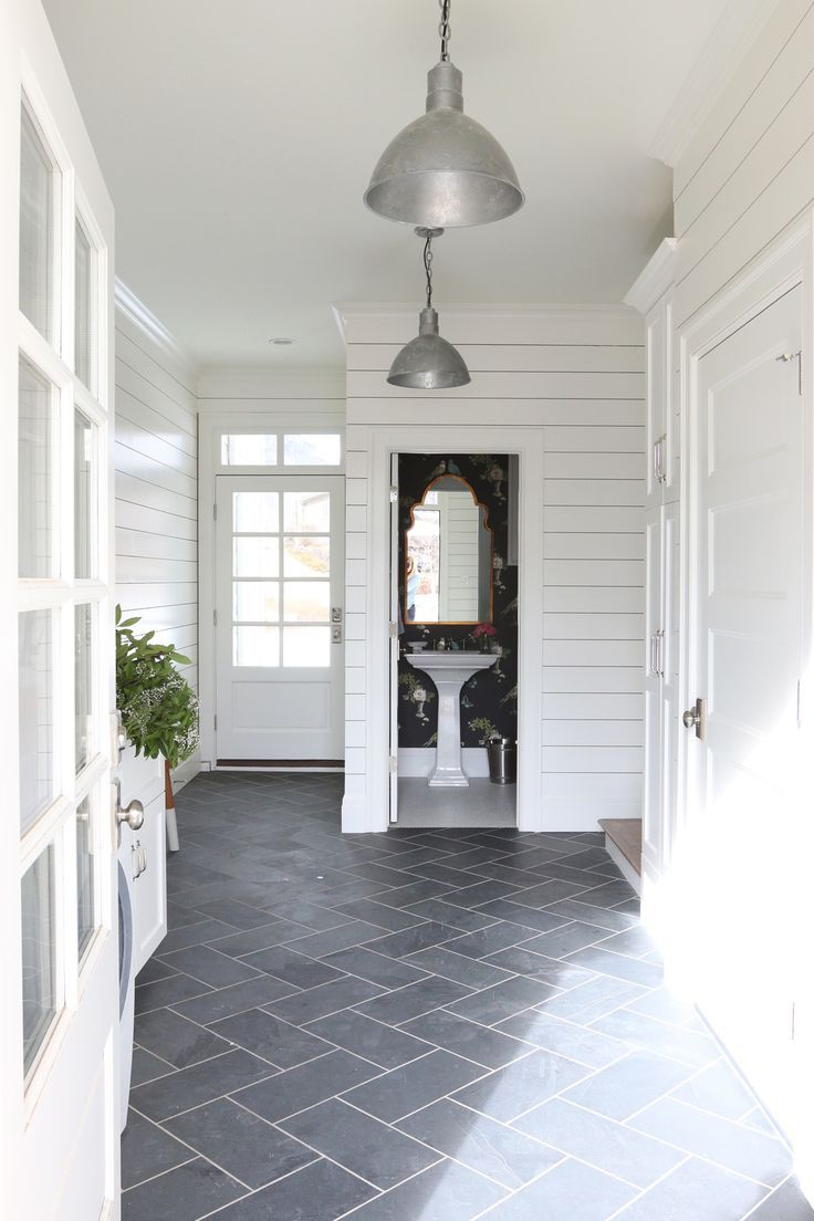 This mudroom gets a lot of  use - laundry, snow covered boots and a place for my mom to do her flowers.  Oh, and it connects to the garage making it the primary entrance on most  days. We selected materials to meetboth form and function - from the slate  herringbone floors, to the shiplap walls and butcher block counters.