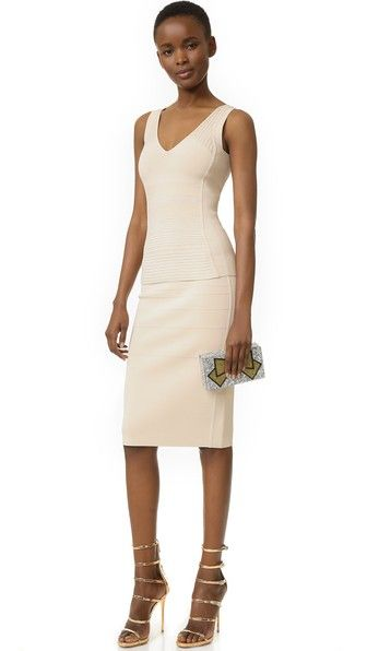 Raised stitches form tonal patterns on this figure-hugging Narciso Rodriguez tank. Double V neckline. Wide straps.