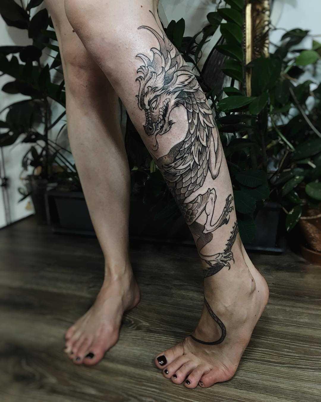 Cool Dragon Tattoo On The Left Calf Dragon Tattoo Leg Dragon Tattoo Wrapped Around Arm Dragon Tattoo Calf