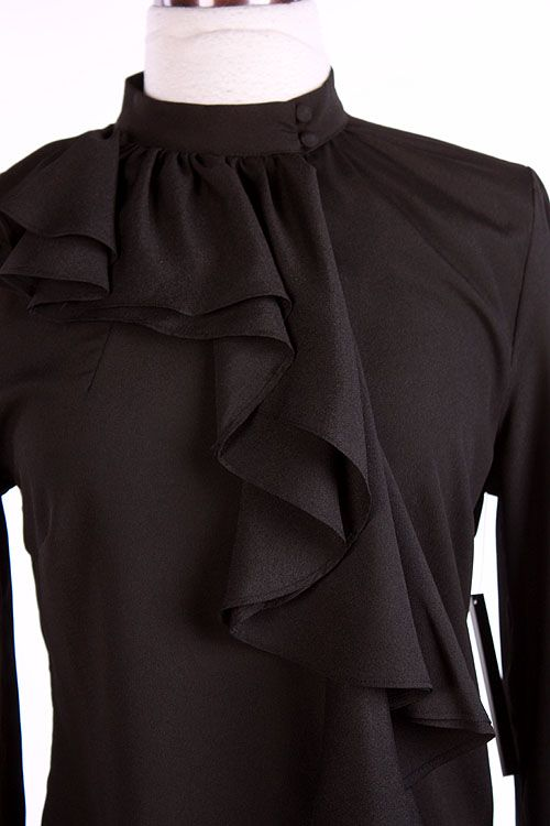 I bought this last week.  Perfect fit, and very flattering!  Jade Mackenzie - Black Side Ruffle Top, $32.00 (http://www.jademackenzie.com/black-side-ruffle-top/)