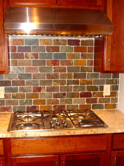 Shaker Heights OH Kitchen Remodel: Kraftmaid Cherry Cabinets, the tile shop copper rust slate tile backsplash, GE stainless steel appliances