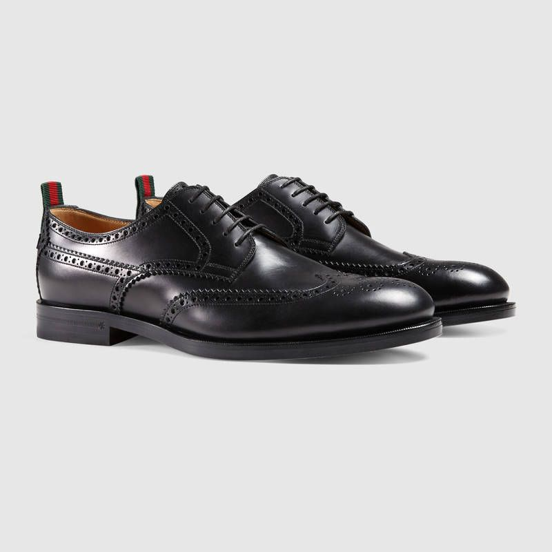 edd517063526 Shop the Leather lace-up by Gucci. A lace-up dress shoe in smooth leather  with perforated details and Web ribbon.