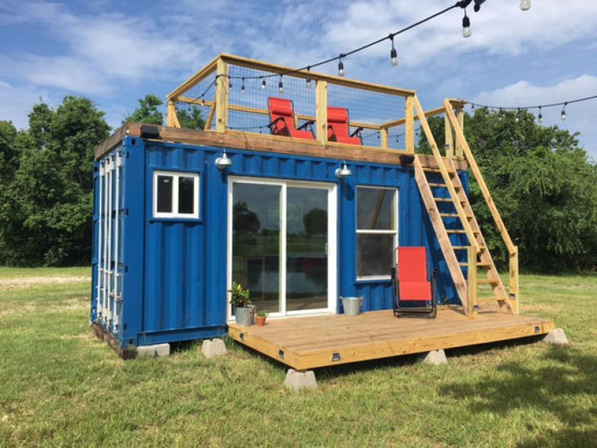 a simple 20 foot shipping container is transformed into the perfect cabin getaway with charming. Black Bedroom Furniture Sets. Home Design Ideas
