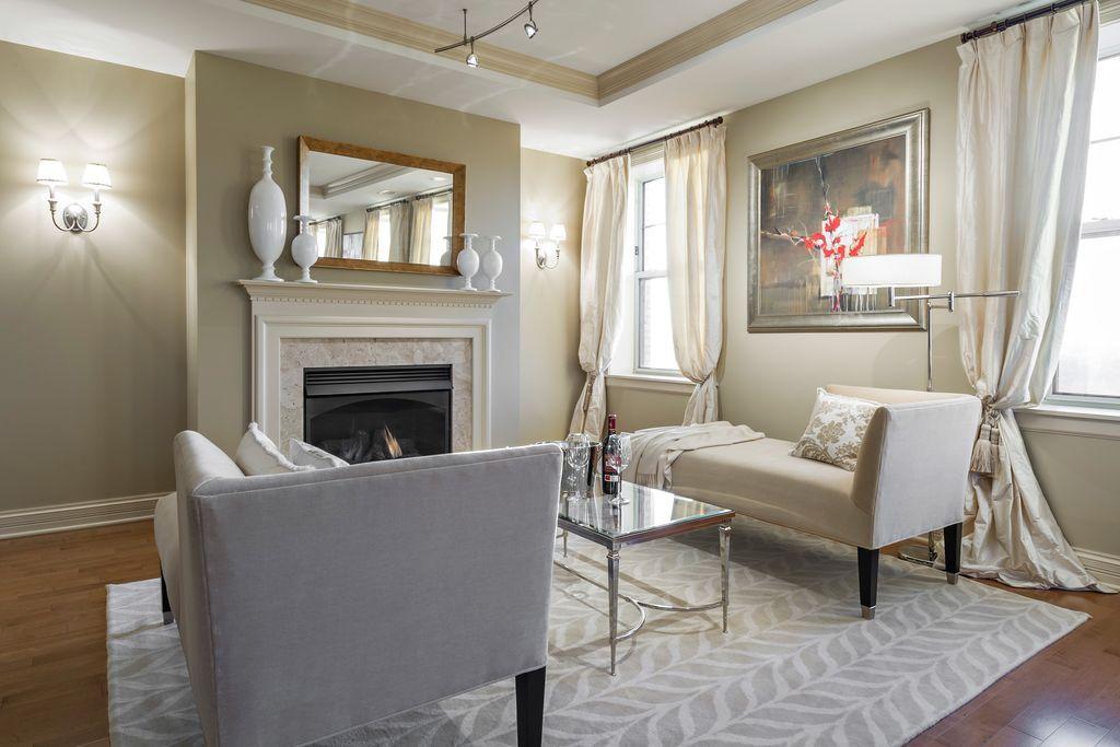 Traditional Master Bedroom with metal fireplace Hardwood