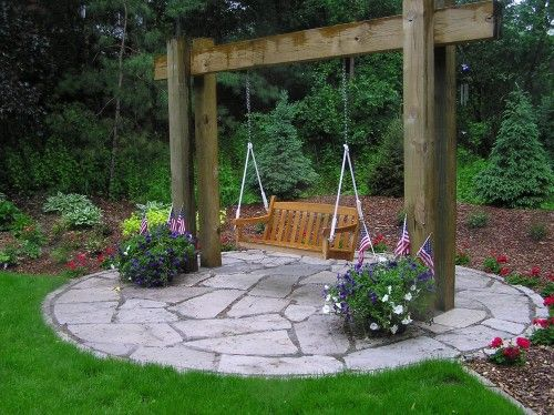 I Love The Patio Area Here This Would Be Great In My Backyard I D Put In A Fire Pit Rather Than The Swing Backyard Garden Garden Swing Backyard Landscaping