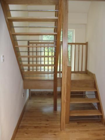Open Tread Oak Staircase With Metal Rods
