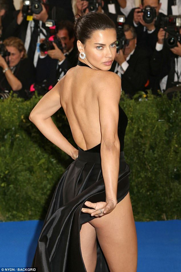 8edb33d82cf8 Adriana Lima flashes underwear with sky-high slit at Met Gala. Booty-ful:  The Brazilian beauty put her cheeky side on show in the black gown.