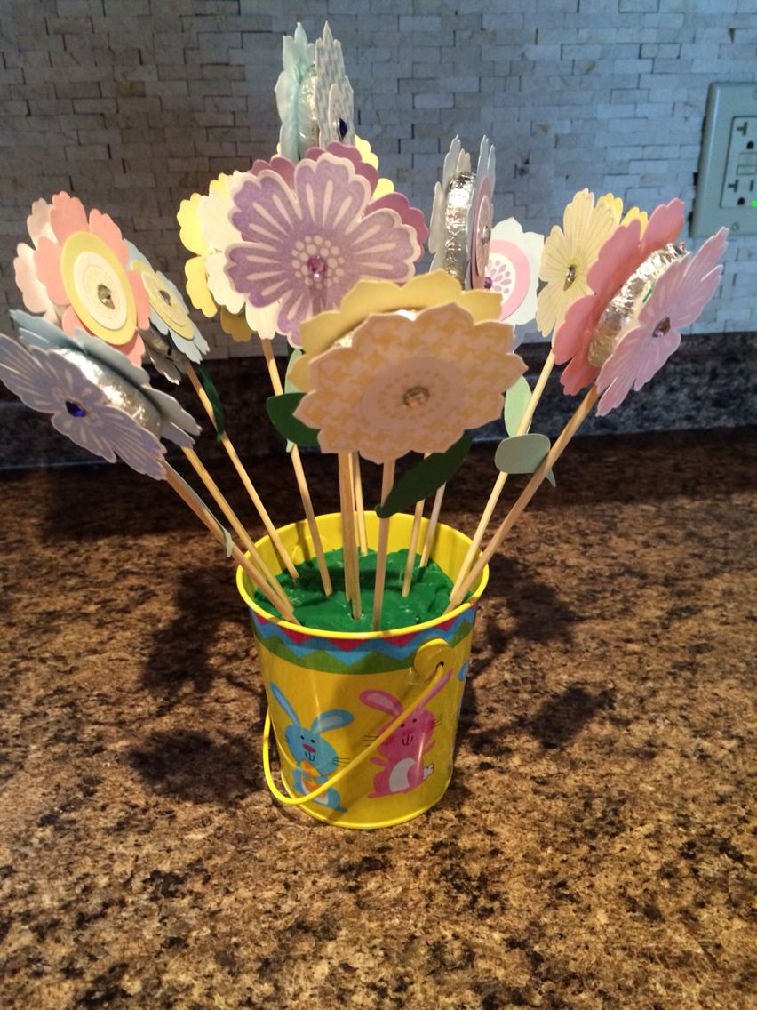 Easter centrepiece. There is a peppermint patty in the middle of the flowers!