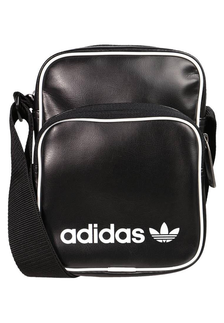 adidas Originals. VINTAGE - Bandolera - black. Compartimentos bolsillo para  teléfono móvil. Estampado estampado. Forro poliéster. 43d911effc1