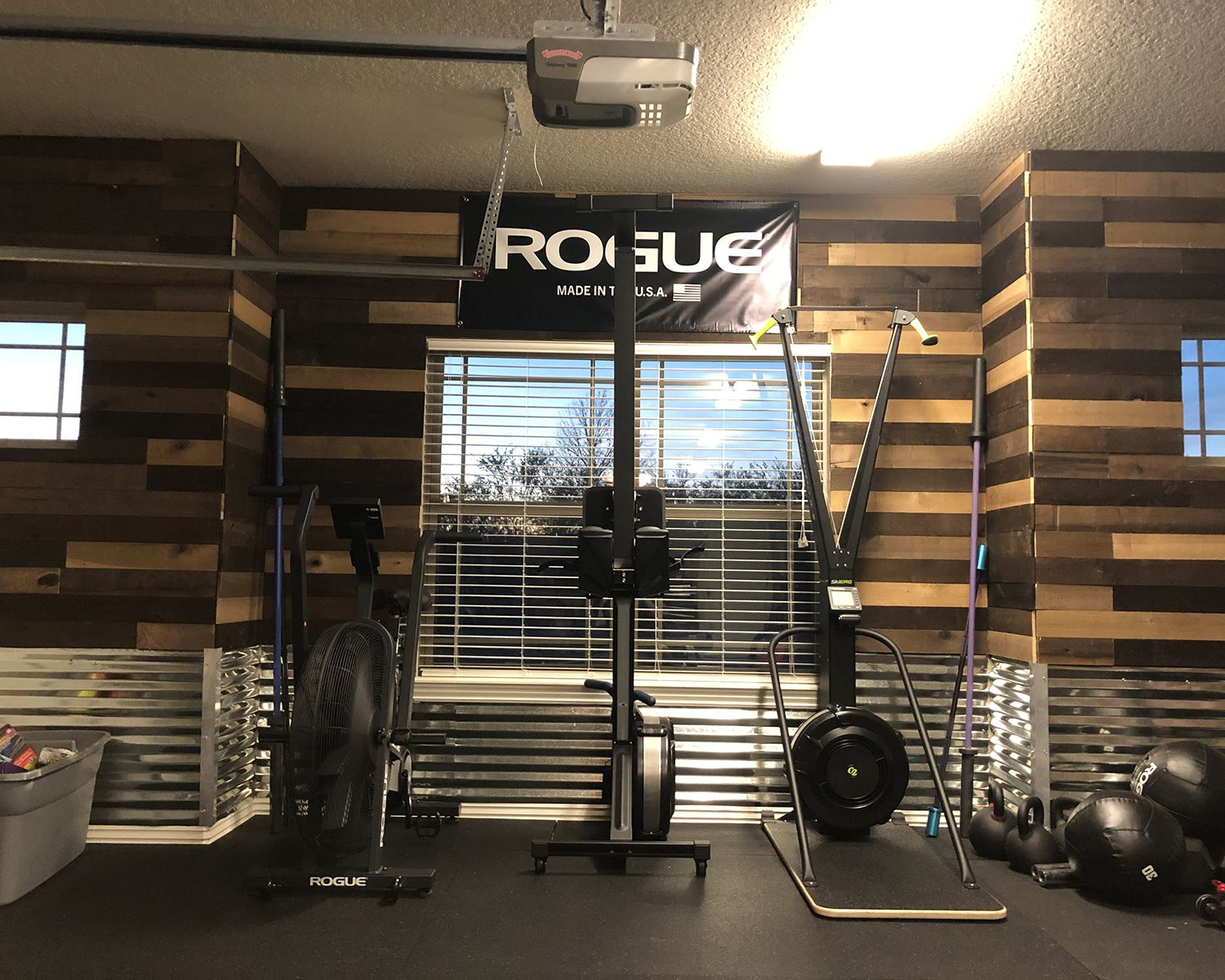 Weathered wall boards are a great fit in this garage gym by zack