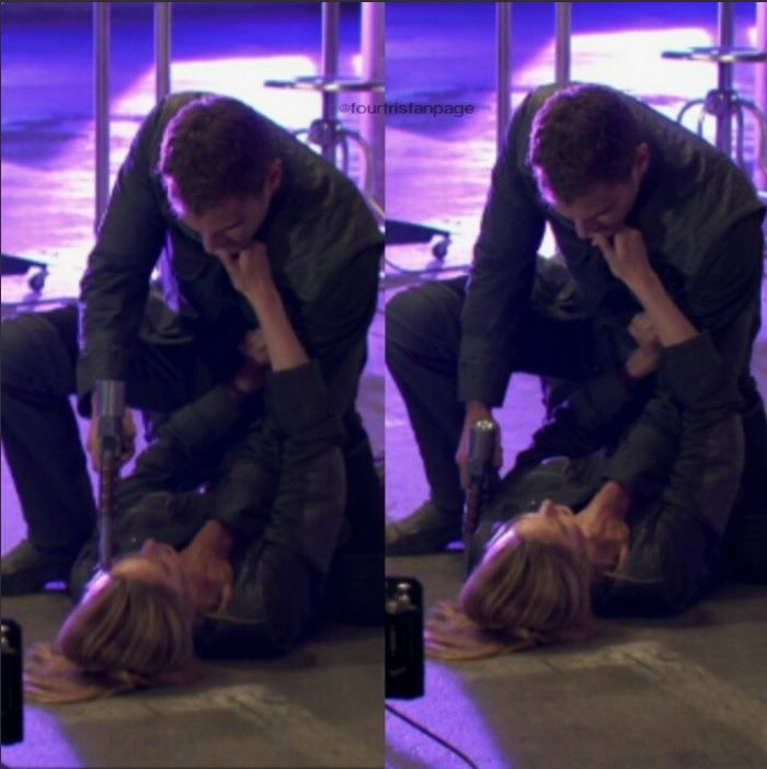 He's on top of her. She's touching his lips. asdfgjkl I can't even