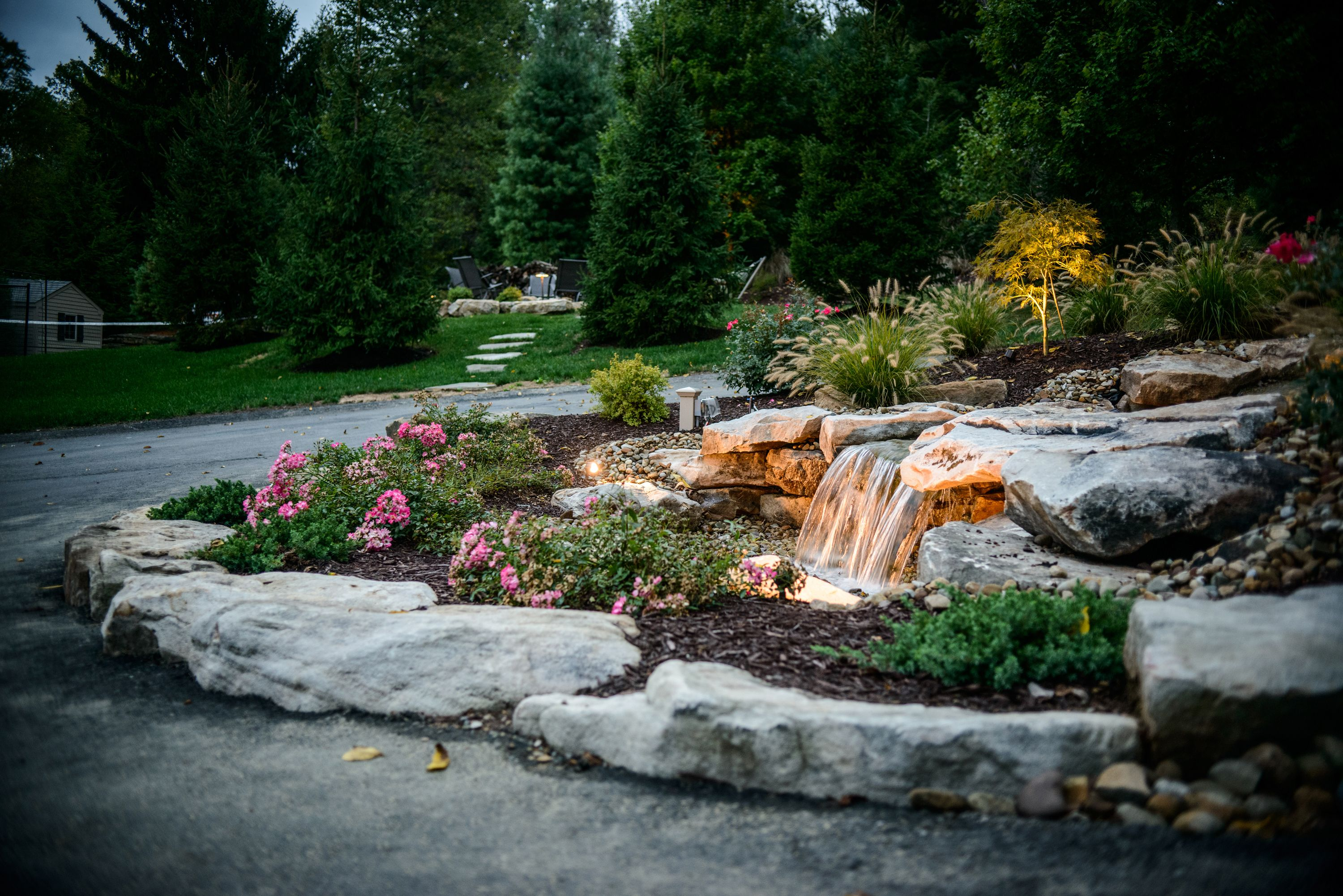 Build your waterfall in your driveway roundabout water for Circular garden ponds